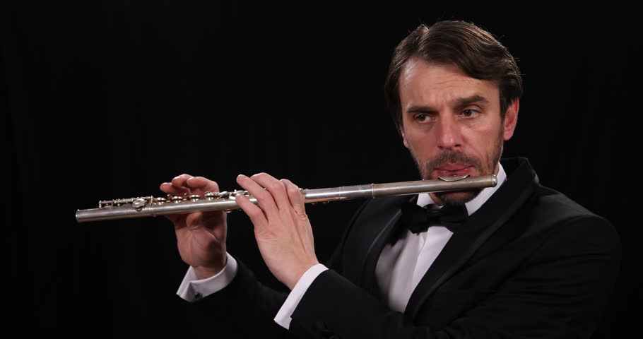 Mature Flutist Musician Man Playing Flute Instrument Symphonic Classic Orchestra