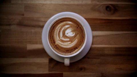 A Pumpkin Spice Latte Art Coffee Mug on Wooden Background