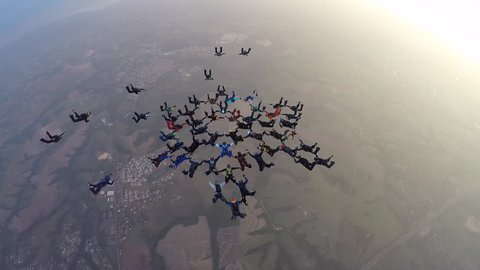 skydiving formation in beautiful sunset