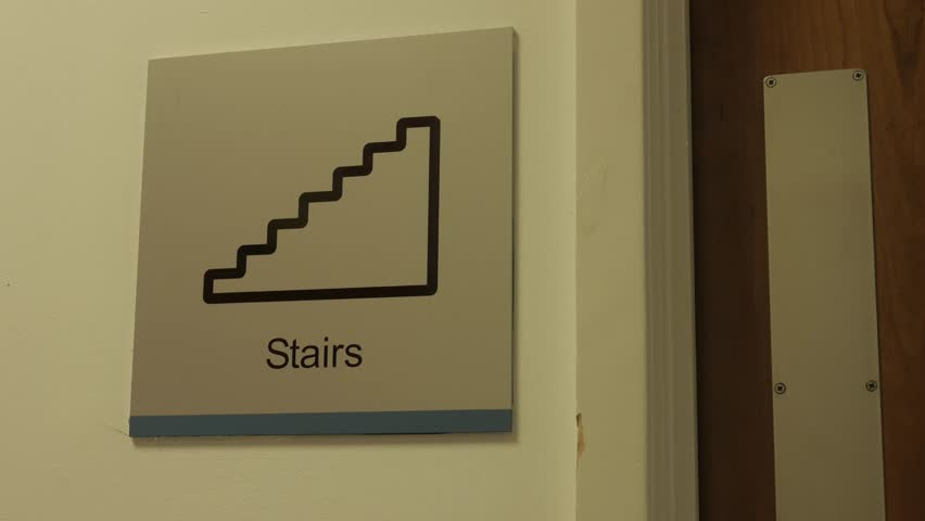 Stairs Sign with Person Walking Through