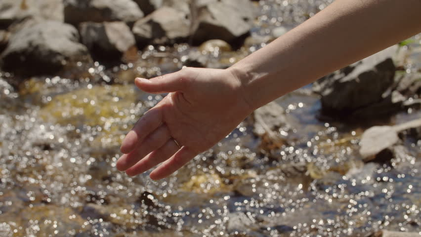 The girl draws water in a clean mountain stream #31940137