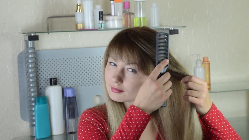 girl brushing her hair hairbrush