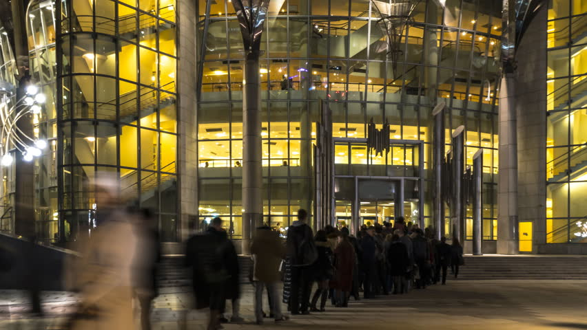 The queue of people at the entrance to a music concert in modern concert hall, time lapse