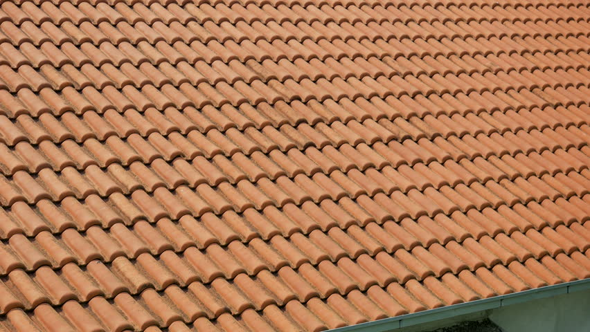 orange clay tiles on the roofs of houses in Montenegro
