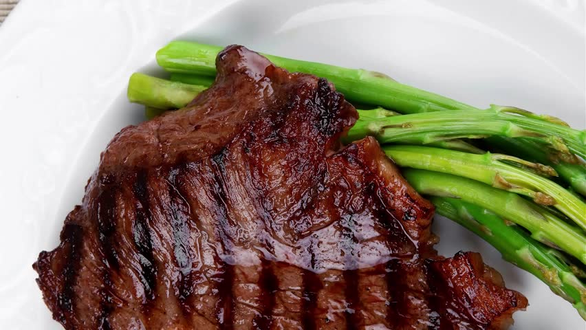 Meat Table Rare Medium Roast Beef Fillet With Asparagus Served On White Plate With Cutlery