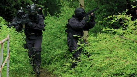A Specail Force Squad walk outside in a wilderness area upstairs. - Close Up