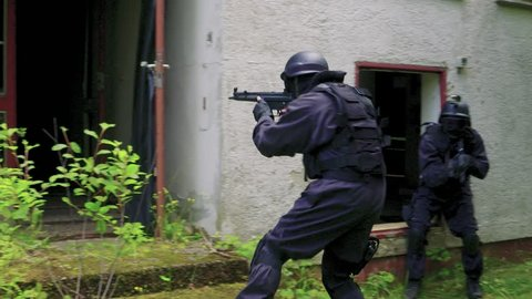 A Special Force Squad storm in a house.