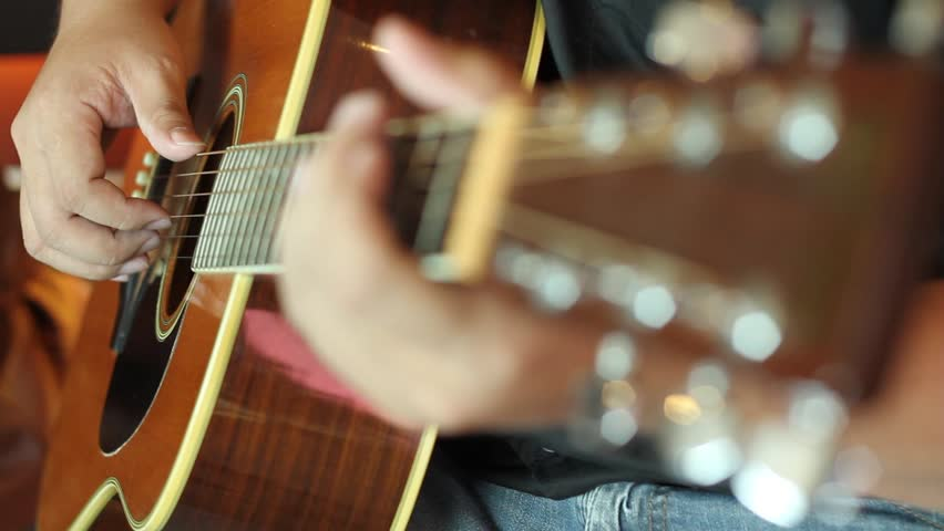 hd video of gutiarist playing acoustic guitar/acoustic guitarist/guitarist playing acoustic guitar
