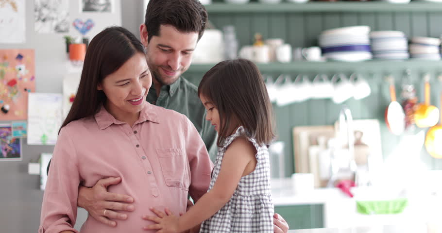 Pregnant mother with daughter and family | Shutterstock HD Video #32027509