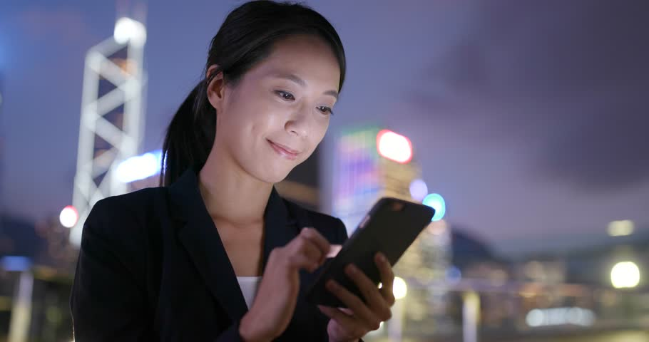 Business woman working on mobile phone in Hong Kong at night  | Shutterstock HD Video #32037547