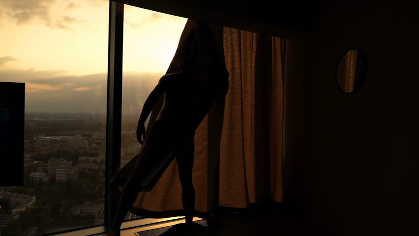 Silhouette of man unveil curtains from window at home, super slow motion 240fps  #32038657