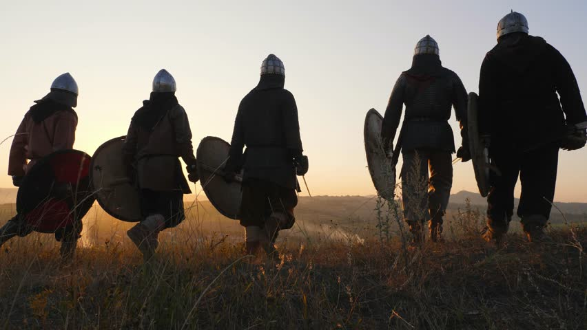 Warriors vikings going and stoping in field and look at beautiful sunset.   Shutterstock HD Video #32043967