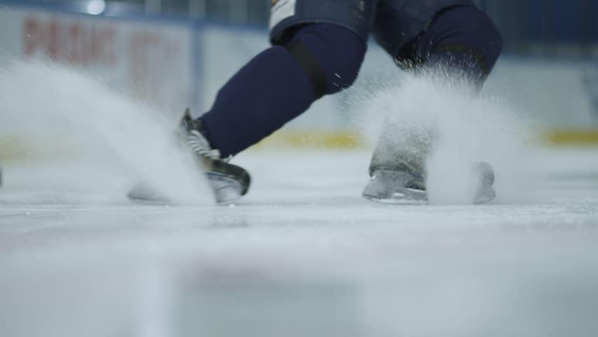 Ice hockey. Close-up of hockey skates. The hockey player does the braking on the ice.