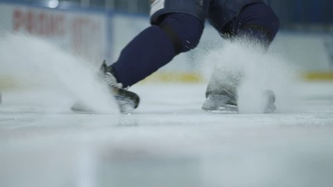 Ice hockey. Close-up of hockey skates. The hockey player does the braking on the ice.
