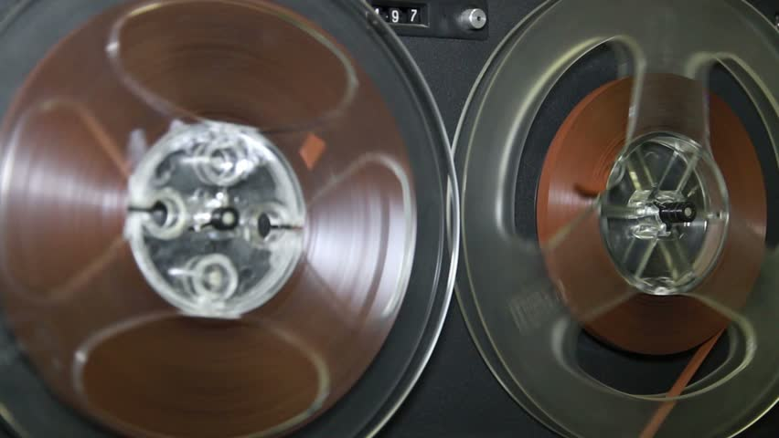 Old retro Reel Audio Recorder reels spinning