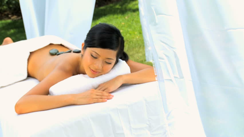 Beautiful Asian Chinese Girl Enjoying Body Massage Outdoors At A Luxury Health Spa -9126