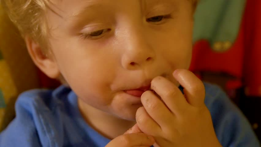 Blond Haired Toddler Boy Eats Pasta In Slow Motion While Sitting His Living Room High