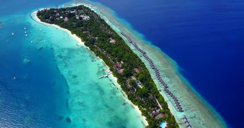 v09498 five 5 star resort water bungalows in Maldives with drone aerial flying view on white sand beach on tropical island
