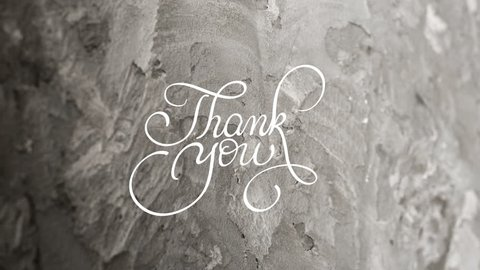 Written animation Thank you calligraphy lettering text with Ornate frame elements on gray dirty grunge background. Vintage and filigree decoration. Filigree divider animation words