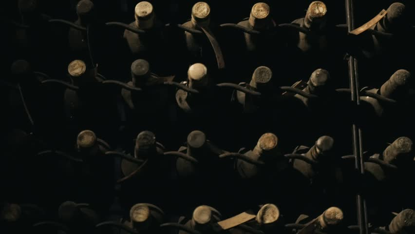 some very old and dusty wine bottles in a wine cellar, porto, portugal