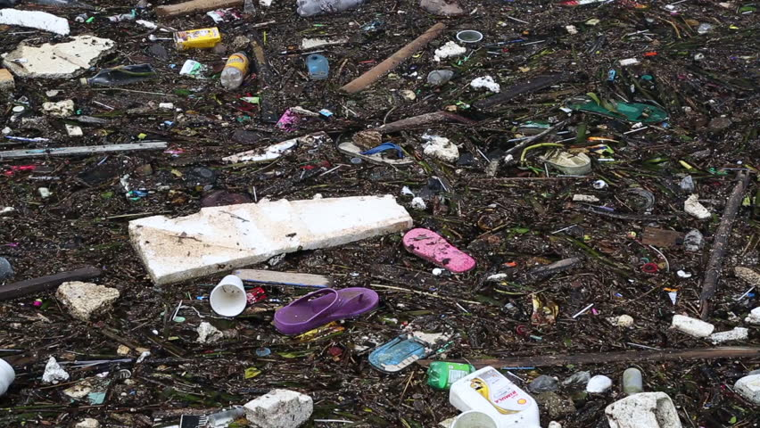 PUERTO PRINCESA, PALAWAN, PHILIPPINES - OCT 25: Plastic, rubber, polystyrene and other garbage floating in ocean on October 25, 2017 in Palawan, Philippines