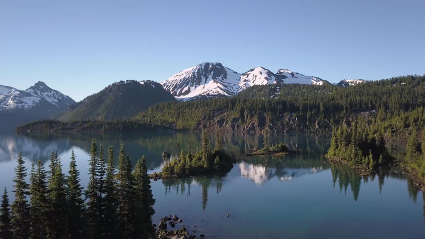 Aerial landscape view of the beautiful rocky islands in glacier lake with mountains in the background. Picture taken in Garibaldi near Squamish, North of Vancouver, British Columbia, Canada. | Shutterstock HD Video #32141707