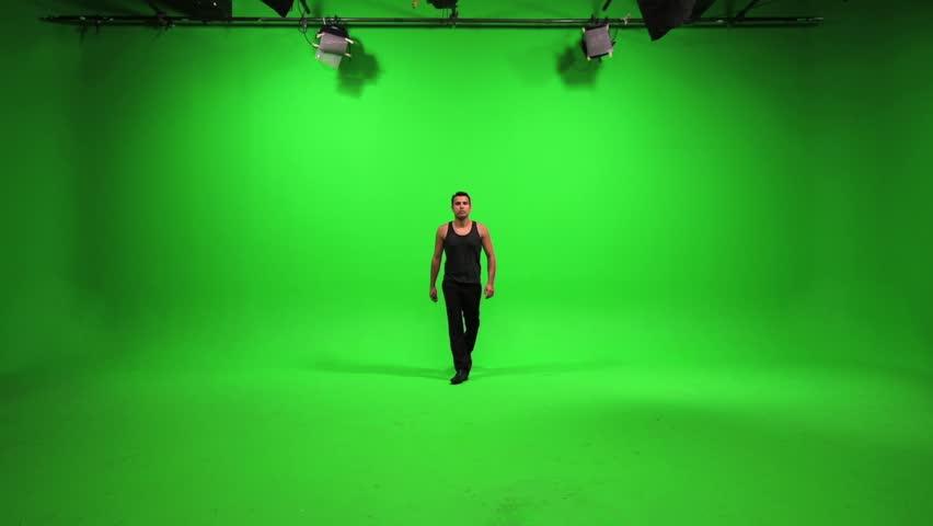 green screen male model walking towards camera