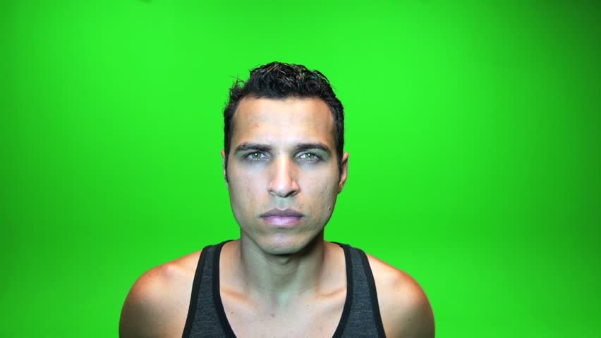 handsome man facing camera against green screen. young latino male model. body shape. person people. isolated background. atletic