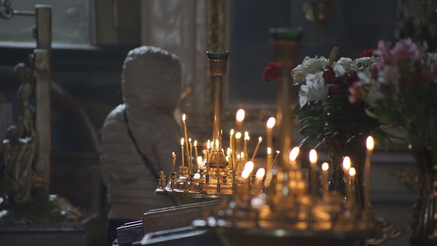 Wax candles burn in the church during the festive prayer | Shutterstock HD Video #32182477