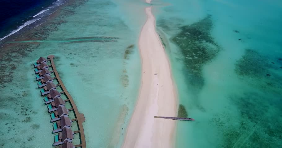 v09439 five 5 star resort water bungalows in Maldives with drone aerial flying view on white sand beach on tropical island