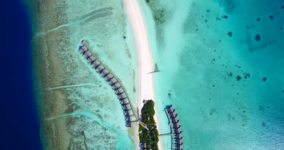 v09453 five 5 star resort water bungalows in Maldives with drone aerial flying view on white sand beach on tropical island