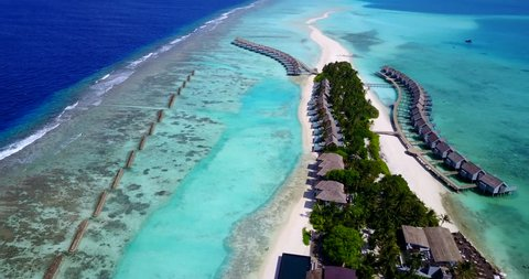 v09428 five 5 star resort water bungalows in Maldives with drone aerial flying view on white sand beach on tropical island