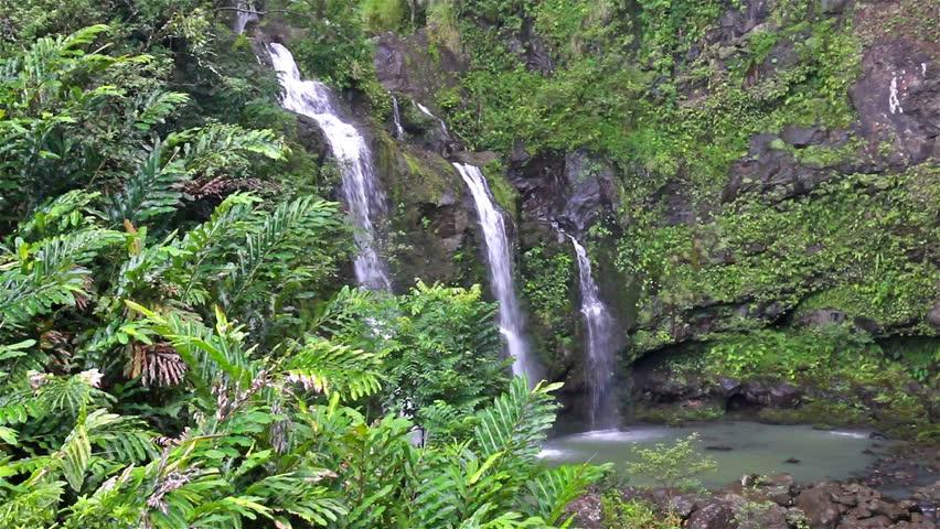Three waterfalls in a lush tropical setting along the Road to Hana in Maui, Hawaii