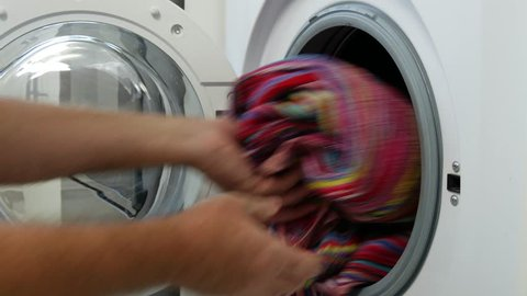 Man Put Dirty Clothes in Laundry Machine (Ultra High Definition, UltraHD, Ultra HD, UHD, 4K, 3840x2160)