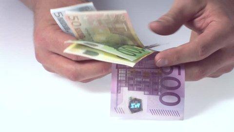 Showing dollars in hands