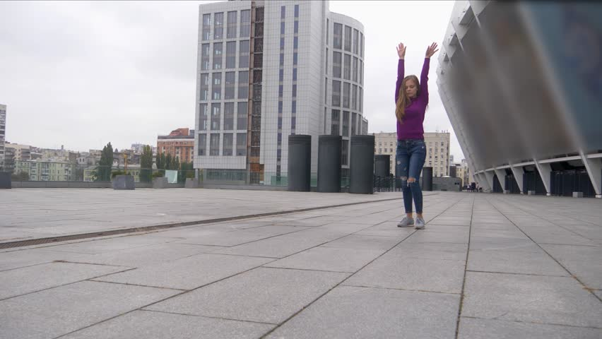 Young attractive woman doing acrobatics with cityscape on background. | Shutterstock HD Video #32226517