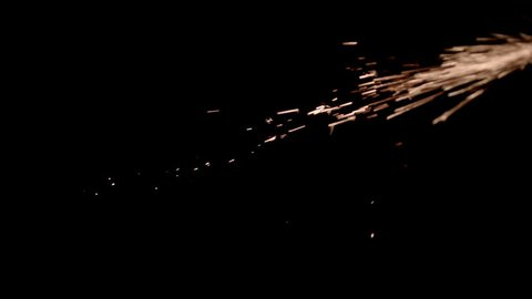 The Metal Sparks stock video clip has sow motion footage of metal sparks flying in the air over a black background. Drop it in and change its blending mode to remove the black background.