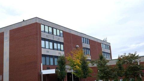 Establishing shot of modern college campus dormatory building on overcast day