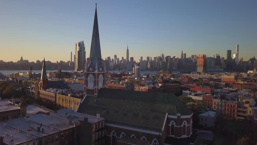 Orbiting clockwise around Greenpoint Brooklyn church with Manhattan skyline in bkrd   Shutterstock HD Video #32248507