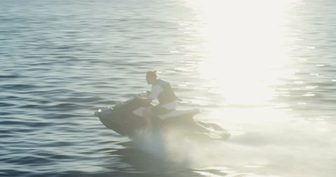 Following Shot of a Man on a Personal Water ?raft Driving Fast. Shot on RED Epic 4K UHD Camera.
