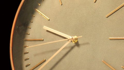Modern Clock Face Fast Time Lapse.  Wood and bronze modern clock ticking accelerated time. Time flies moving fast forward in this time lapse. Clock face running out in high speed.