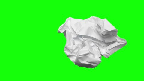 Timelapse of crumpled paper ball on green screen background, shot in the studio