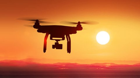 Quadcopter Flying Far Away to the Beautiful Sunset Sun. Modern Electronics Concept. 4k UHD 3840x2160.