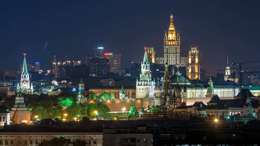 Panoramic aerial view of Moscow timelapse - Kremlin towers, State general store, Stalin skyscraper, residential building at night. Illuminated city from rooftop. Close up