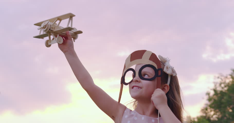 Cute Little Girl Child Playing With Airplane Toy In Park At Sunset Golden Hour Childhood Innocence Play Concept Slow Motion Shot On Red Epic 8K | Shutterstock HD Video #32280847