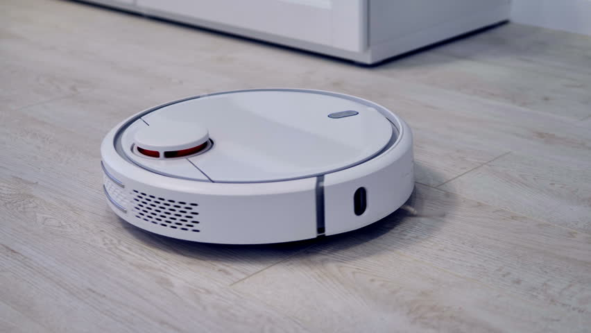Detailed view on a self-moving robotic vacuum on the floor.     | Shutterstock HD Video #32282497