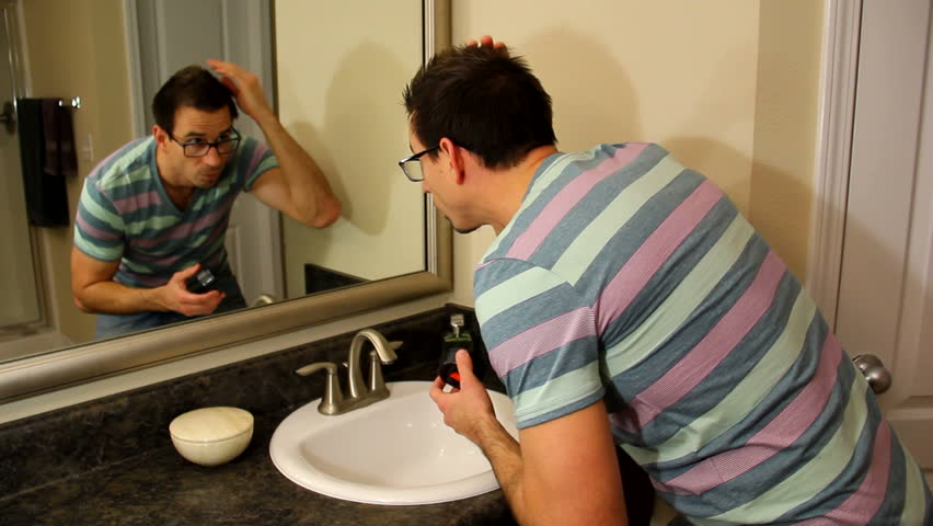 Man Applying Hair Product