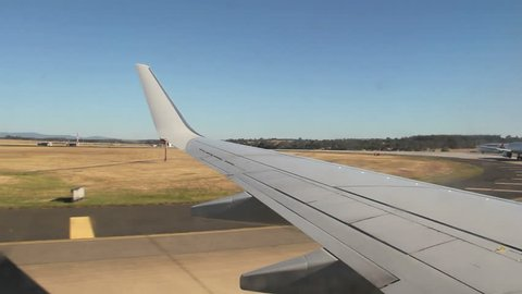 MELBOURNE, AUSTRALIA - December 18 2012: Qantas jet taxiing by planes. Australia's largest airline, it is the oldest continuously operated airline, and the second oldest airline in the world.