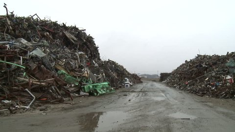 Massive piles of tsunami debris piled high in Rikuzentakata, Japan