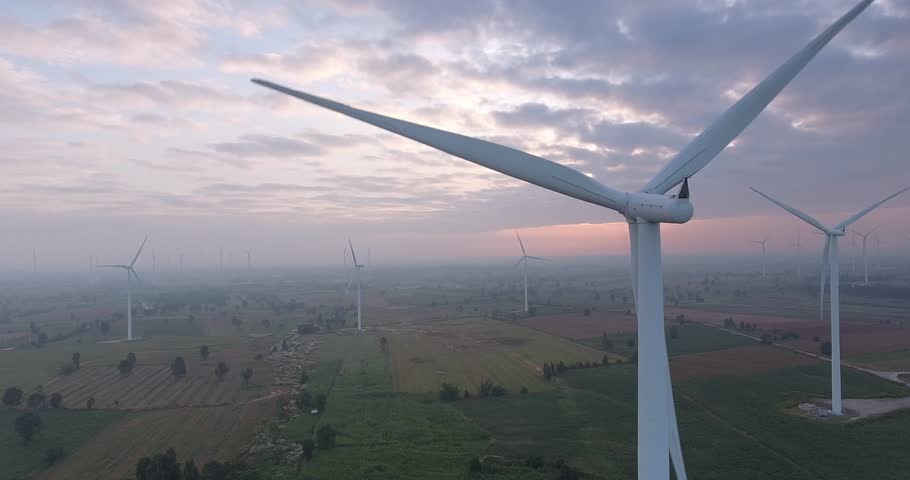 Aerial view of  Wind turbines Energy Production- 4k aerial shot on sunset. 4k drone footage turbines at sunrise with clouds | Shutterstock HD Video #32338297